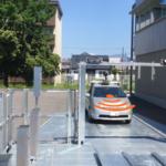 新明和工業と群馬大学、機械式駐車設備で自動運転車の駐車実証実験に成功